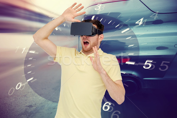 man in virtual reality headset and car racing game Stock photo © dolgachov