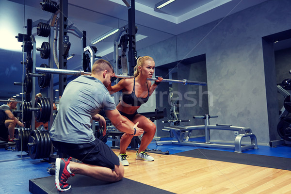Homme femme bar muscles gymnase sport Photo stock © dolgachov