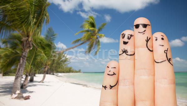 Dedos caras playa viaje Foto stock © dolgachov