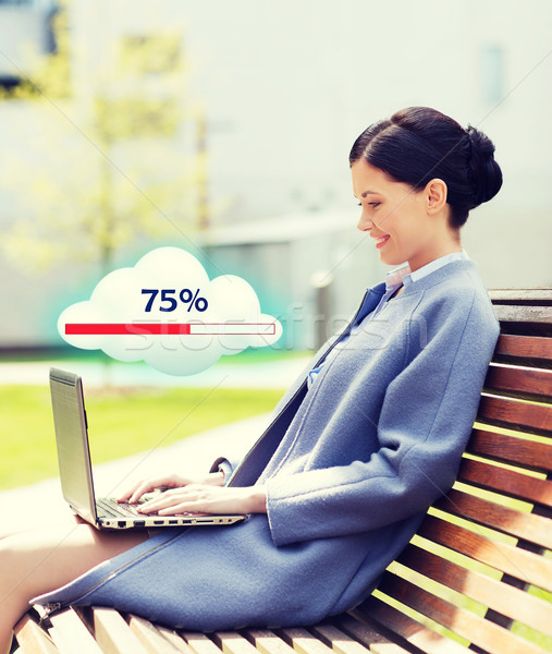smiling business woman with laptop in city Stock photo © dolgachov