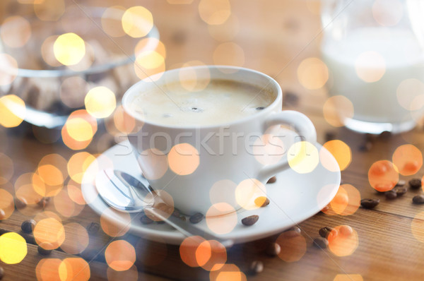 Közelkép kávéscsésze magvak fa asztal koffein tárgyak Stock fotó © dolgachov