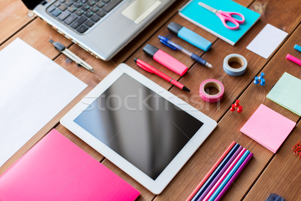 close up of school supplies and tablet pc Stock photo © dolgachov