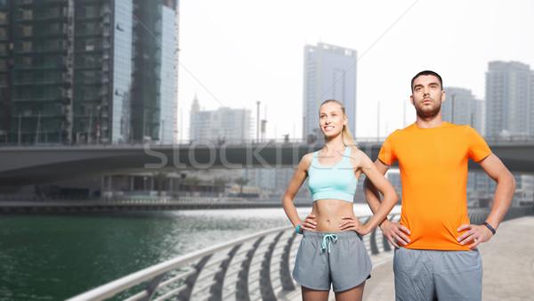 couple exercising over dubai city street  Stock photo © dolgachov