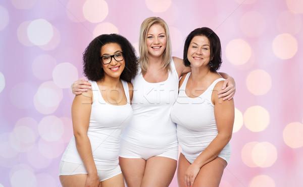 Grupy szczęśliwy plus size kobiet biały bielizna Zdjęcia stock © dolgachov