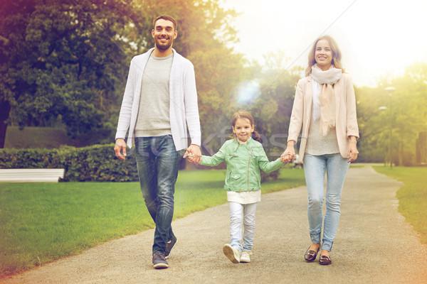 happy family walking in summer park Stock photo © dolgachov