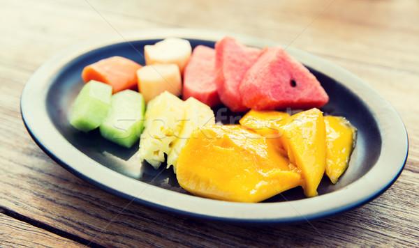 plate of fresh juicy fruits at asian restaurant Stock photo © dolgachov