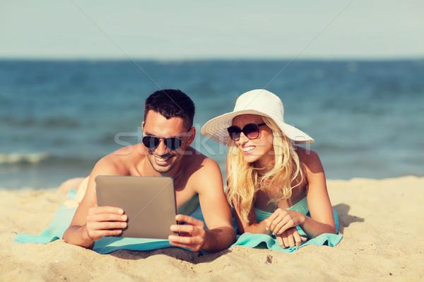 счастливым пару солнечные ванны пляж любви Сток-фото © dolgachov