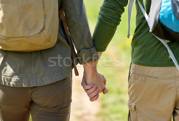 close up of couple with backpacks holding hands Stock photo © dolgachov
