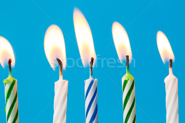birthday candles burning over blue background Stock photo © dolgachov