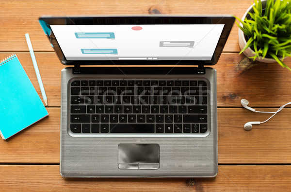 close up of laptop computer with messenger chat Stock photo © dolgachov