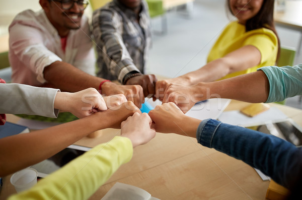 close up of international students hands fist bump Stock photo © dolgachov