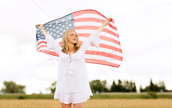 happy woman with american flag on cereal field Stock photo © dolgachov