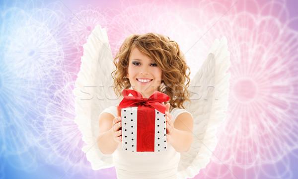 Feliz mulher asas de anjo aniversário dom pessoas Foto stock © dolgachov