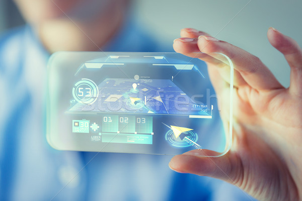 close up of woman with transparent smartphone Stock photo © dolgachov