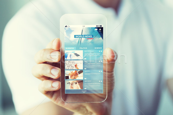 Stock photo: close up of hand with business news on smartphone