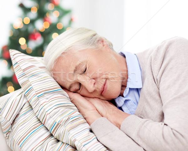 Feliz senior mulher adormecido travesseiro casa Foto stock © dolgachov