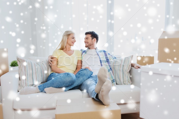 happy couple with big cardboard boxes at new home Stock photo © dolgachov