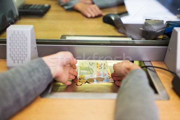 hands taking cash money at bank office Stock photo © dolgachov
