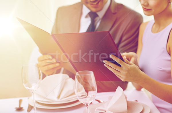 幸せ カップル メニュー レストラン レストランの食べ物 ストックフォト © dolgachov