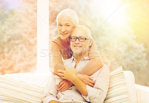happy senior couple hugging on sofa Stock photo © dolgachov