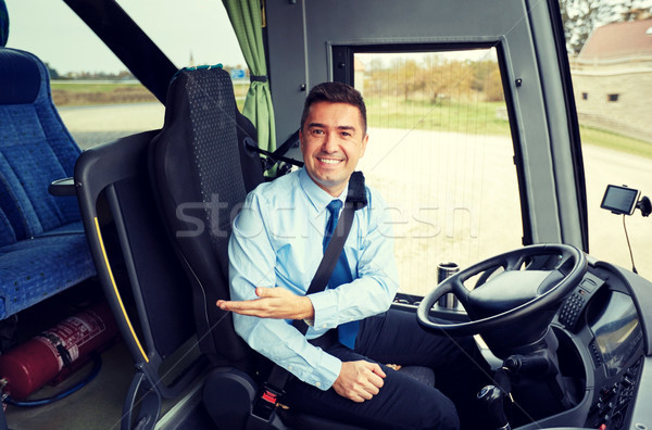 happy driver inviting on board of intercity bus Stock photo © dolgachov