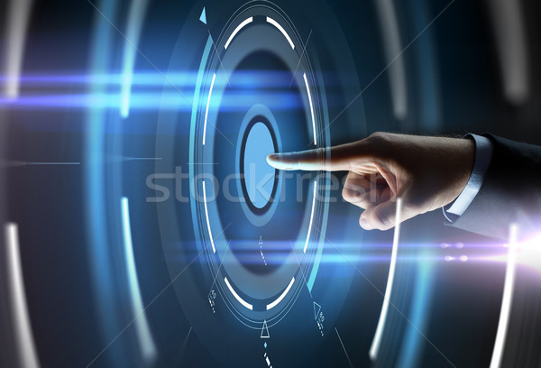 male hand pointing finger to virtual projection Stock photo © dolgachov