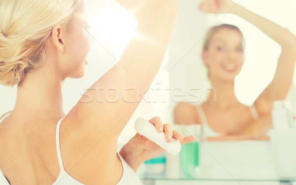 woman with antiperspirant deodorant at bathroom Stock photo © dolgachov