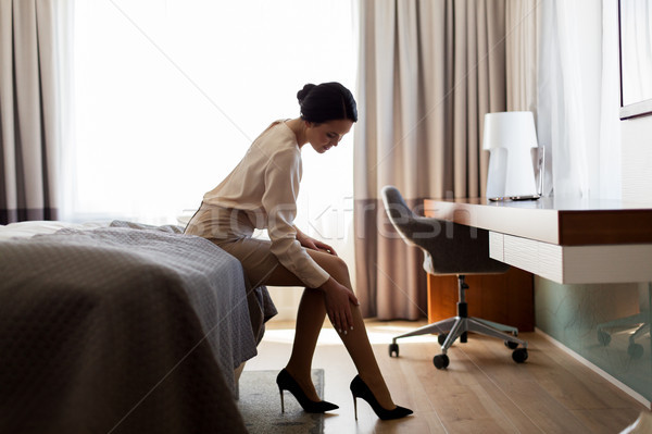 woman sitting on bed in hotel room Stock photo © dolgachov