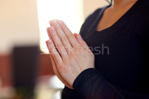 Közelkép szomorú nő imádkozik Isten templom Stock fotó © dolgachov