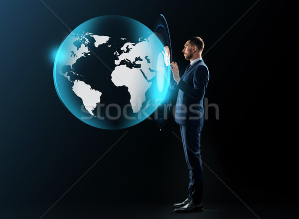businessman in suit with virtual earth projection Stock photo © dolgachov