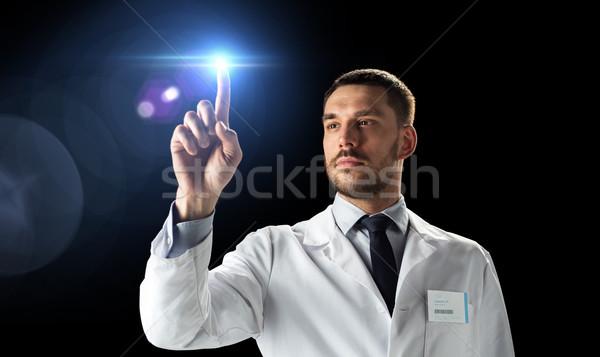 doctor or scientist in white coat with laser light Stock photo © dolgachov
