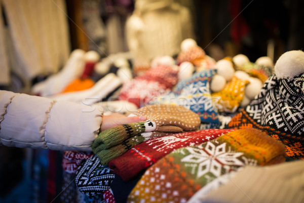 woman buying woolen mittens at christmas market Stock photo © dolgachov
