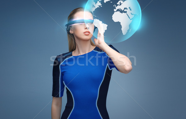 woman in virtual reality 3d glasses with earth Stock photo © dolgachov