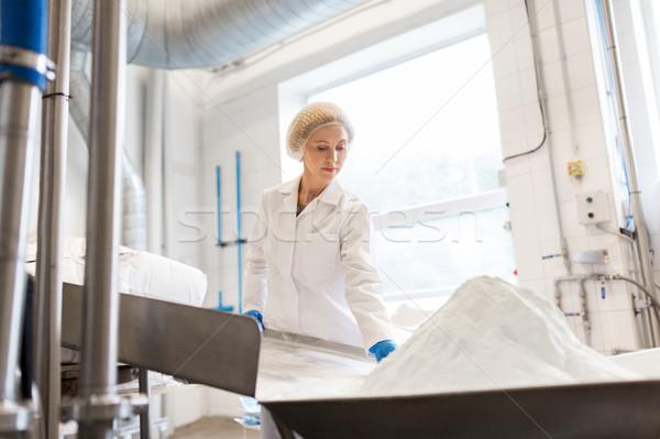 woman working at ice cream factory conveyor Stock photo © dolgachov