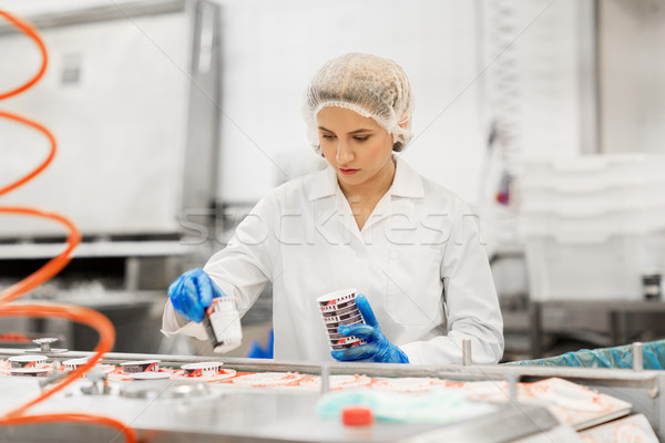 woman working at ice cream factory conveyor Stock photo © dolgachov