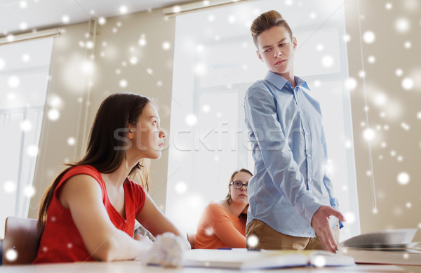 students gossiping behind classmate back at school Stock photo © dolgachov