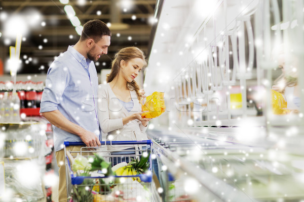couple with shopping cart buying food at grocery Stock photo © dolgachov