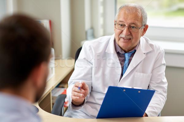 senior doctor talking to male patient at hospital Stock photo © dolgachov