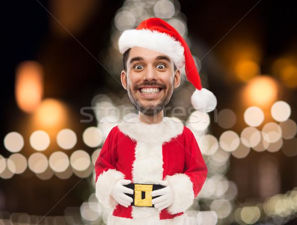 Man kerstman kostuum christmas lichten vakantie Stockfoto © dolgachov