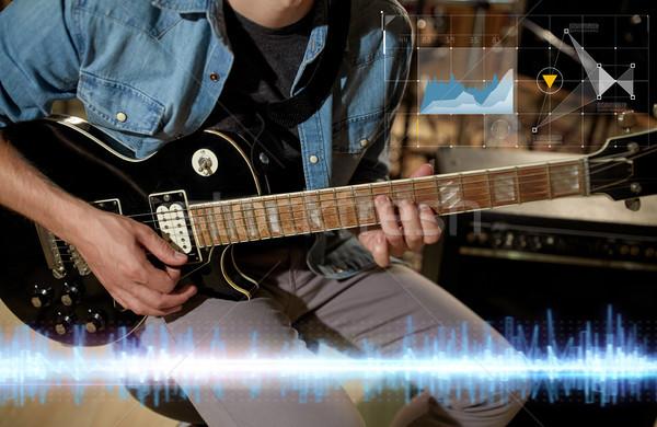 Közelkép zenész játszik gitár stúdió zene Stock fotó © dolgachov