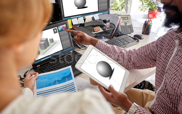 designers with 3d models on laptop and tablet pc Stock photo © dolgachov