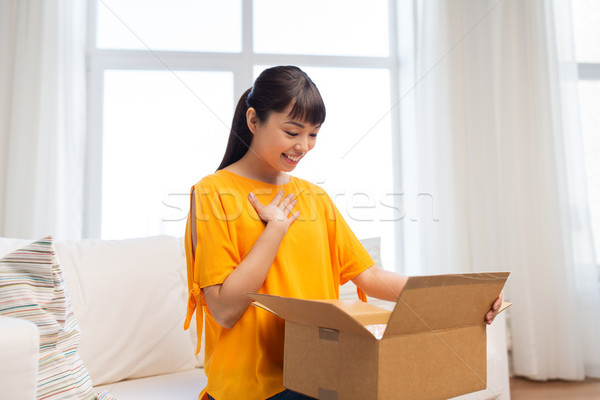 happy asian young woman with parcel box at home Stock photo © dolgachov