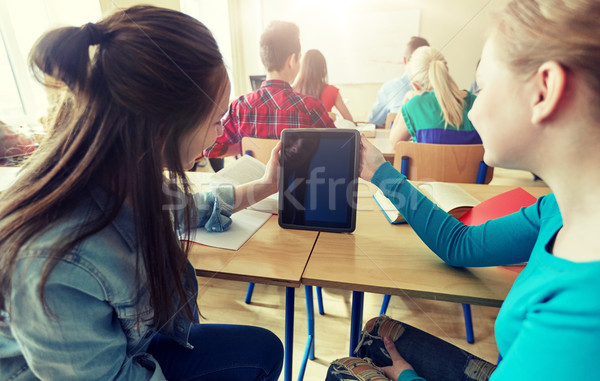 happy student girls with tablet pc at high school Stock photo © dolgachov