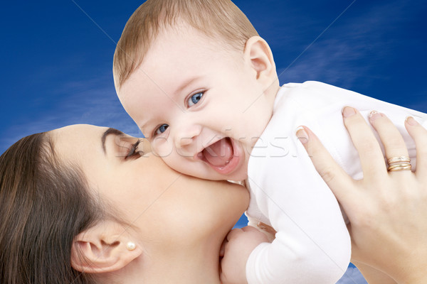 happy mother with baby boy over blue sky Stock photo © dolgachov