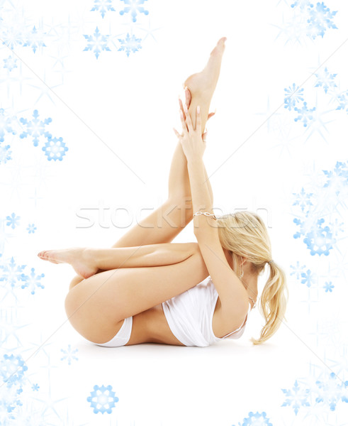 blond in white underwear practicing yoga with snowflakes Stock photo © dolgachov