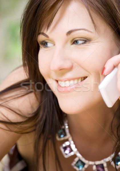 woman with white phone Stock photo © dolgachov