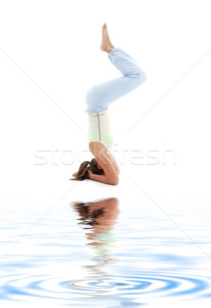 salamba sirsasana supported headstand on white sand Stock photo © dolgachov