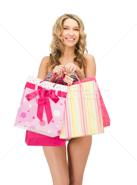 seductive woman in bikini with shopping bags Stock photo © dolgachov