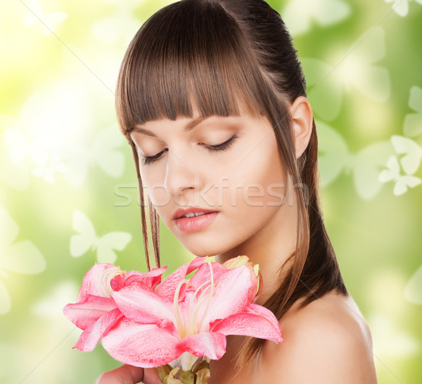 woman with lily flower and butterflies Stock photo © dolgachov
