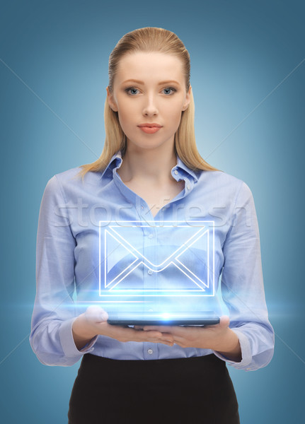 woman with tablet pc sending e-mail Stock photo © dolgachov